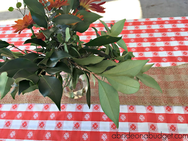 Don't overthink your outdoor wedding. Go easy with these Simple Rustic Floral Wedding Centerpieces from www.abrideonabudget.com.