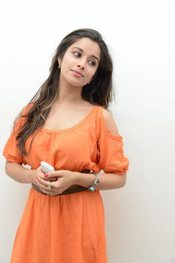 stylish beloved sexy Madhurima latest hot stills in orange mini skirt