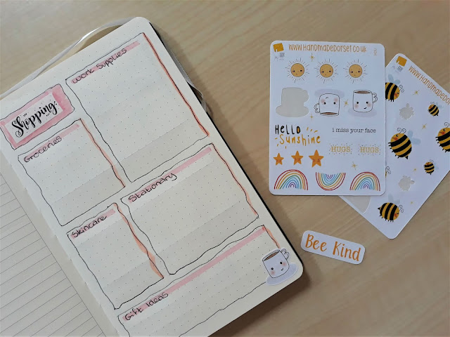 The page shows lots of wiggly textboxes, each for a different category of shopping. It's decorated with an isolation mug sticker from Handmade Dorset