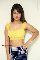 Cute Telugu Actress Shunaya Solanki High Definition Spicy Pos in Yellow Top and Skirt  0029.JPG
