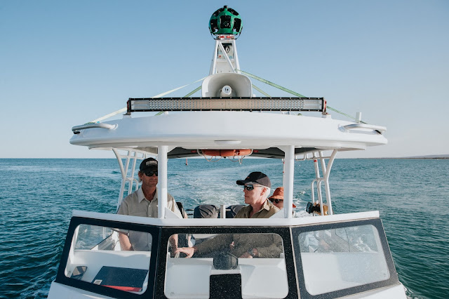 Photo of Kerstin Stender from Parks and Wildlife Service WA and the Google Street View Trekker keeping an eye out for whale sharks as they cruise the Ningaloo Coast.