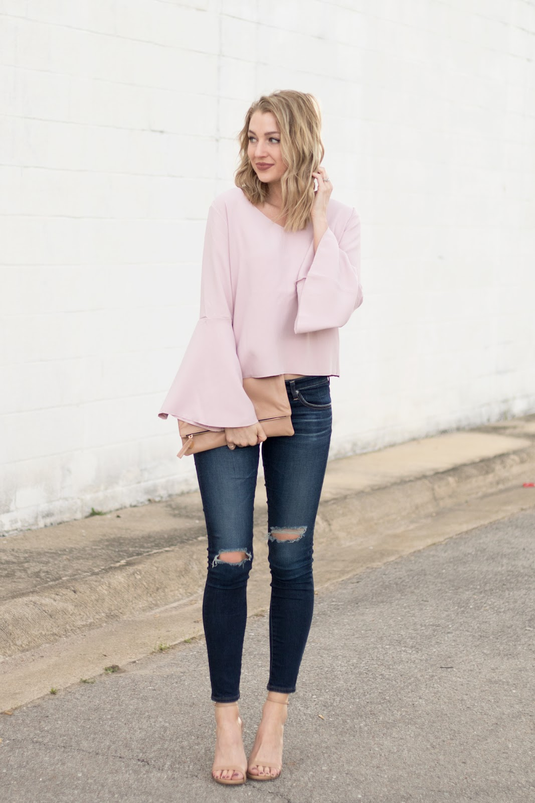 Bell sleeve top with distressed skinnies