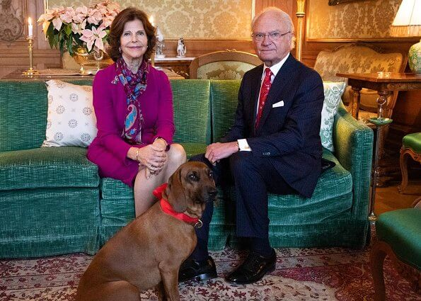 King Carl Gustaf and Queen Silvia traditionally celebrate Christmas at Drottningholm Palace. he photo also shows the King's dog Brandie