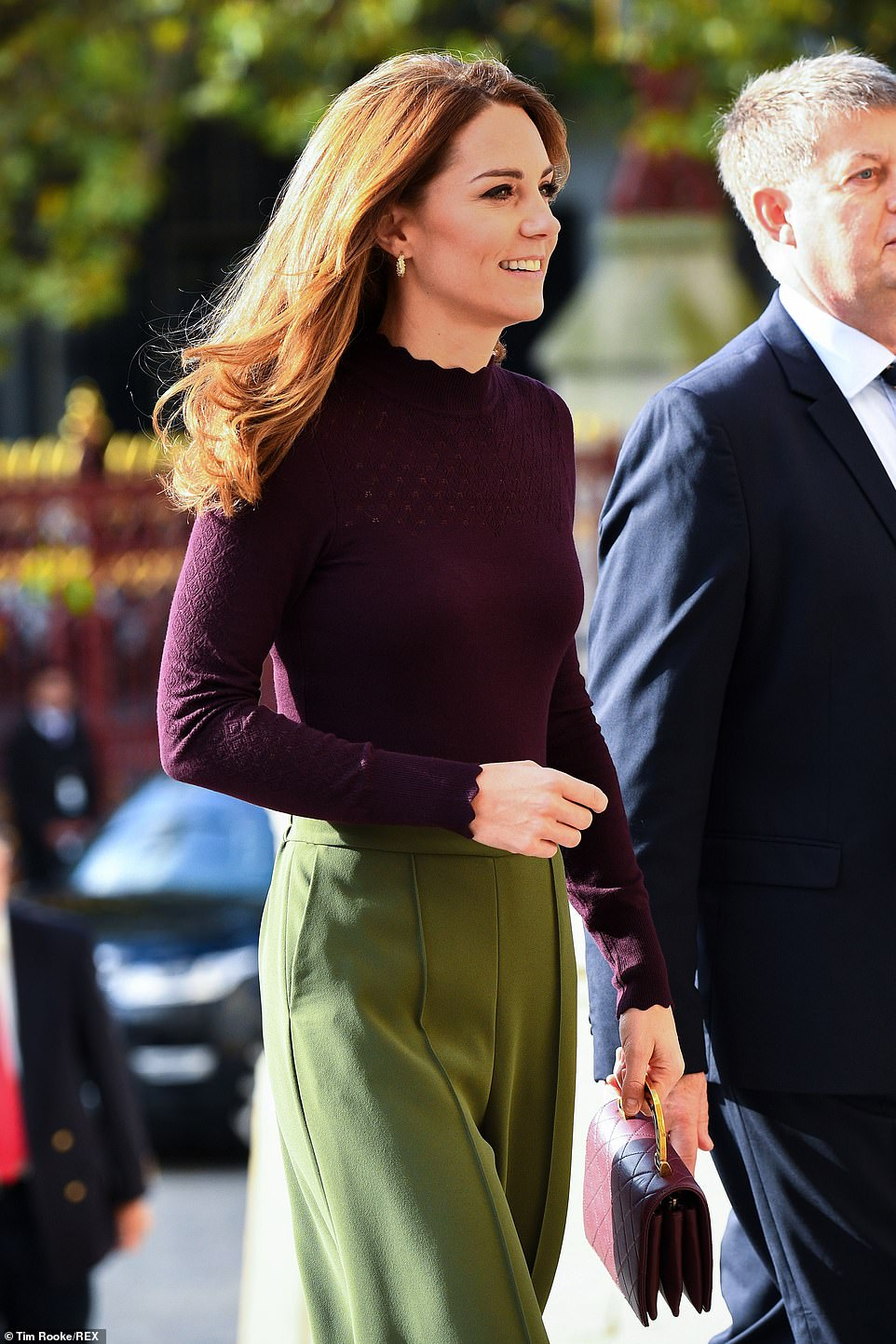 Kate Middleton Stuns in Green Culottes, a Plum Sweater, and Matching Chanel Bag at Angela Marmont Centre
