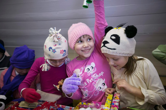 Girls receiving shoebox gifts