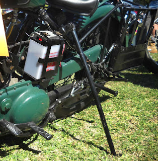Long prop rod holds up motorcycle.
