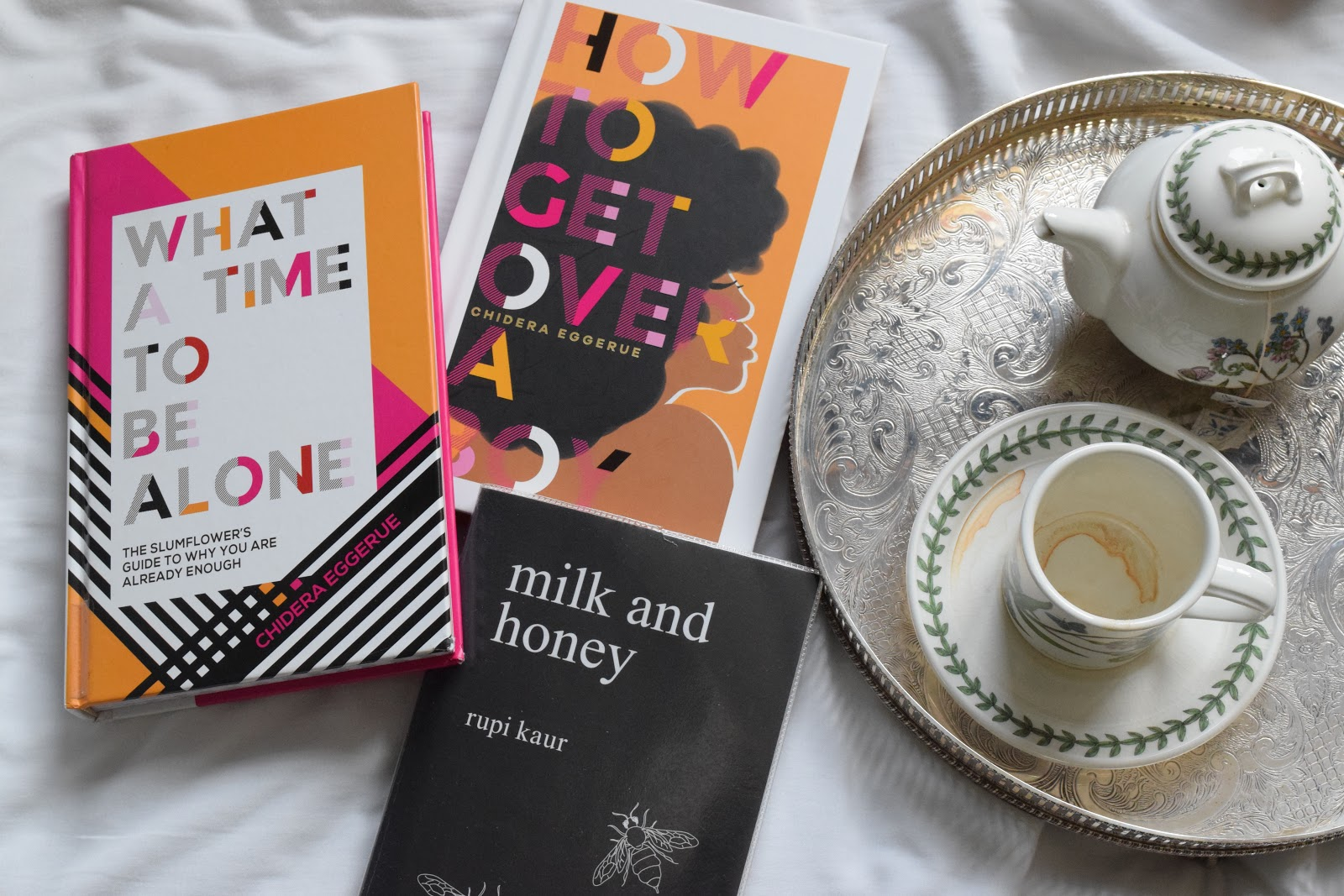 What a time to be alone by Chidera Eggerue, milk and honey by Rupi Kaur and a teapot with a tea cup on a silver tray
