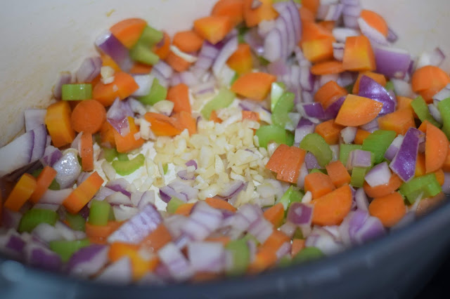 The carrot, onion, celery, and garlic chopped and in the pot on the stove.