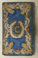 An embroidered blue cover.