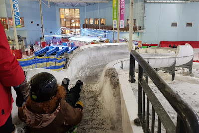 Snow Play Chill Factore review boy on the Ice Slide luge