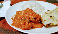Serving butter chicken with rice and naan