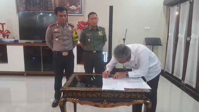 Pemkab OKI, Kodim dan Polres Tanda Tangani NPHD Pengamanan Pilkada