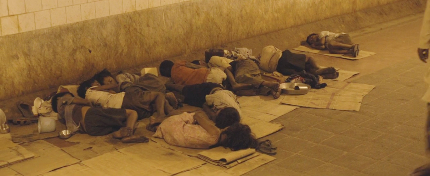 Lion - Kids sleeping on the footpath