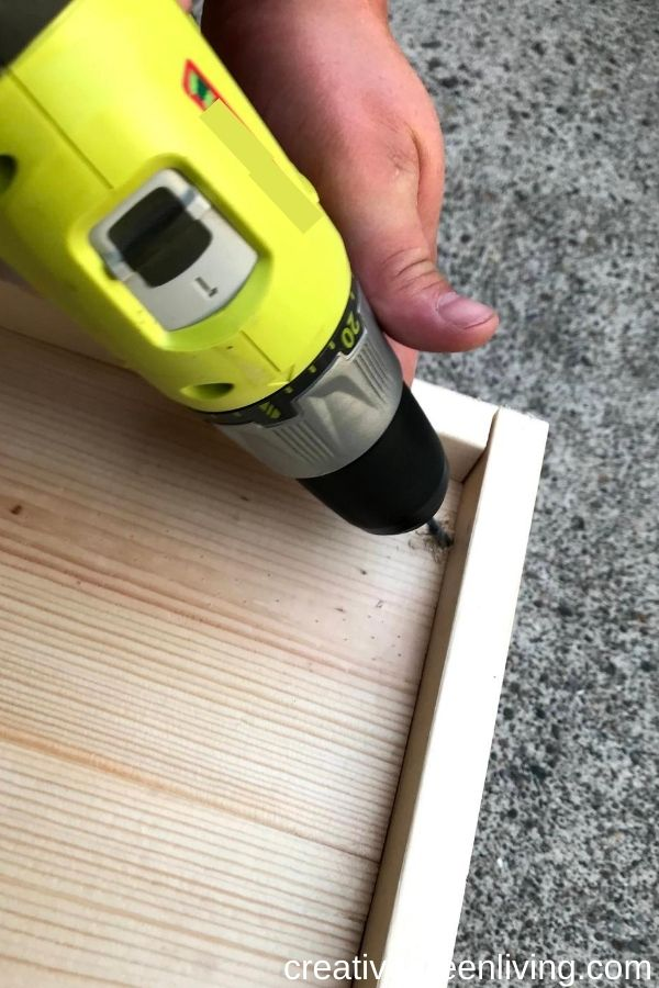 How to make a DIY Chicknic Table - free plans for how to build a chicken picnic table including step-by-step directions - how to drill holes in your chic nic table so it doesn't fill with water in the rain