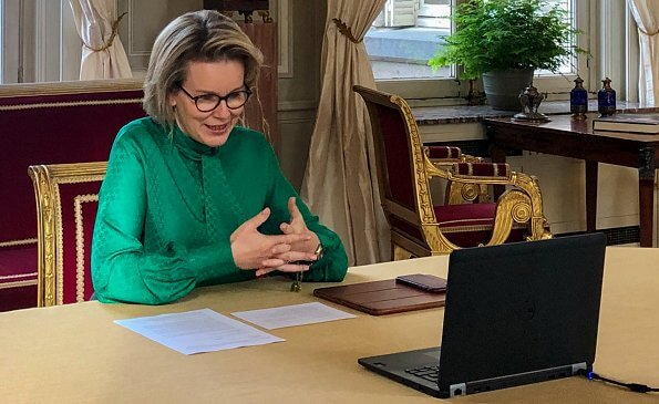 Queen Mathilde wore a rosetta insignia green bow-detail crape blouse by Carolina Herrera