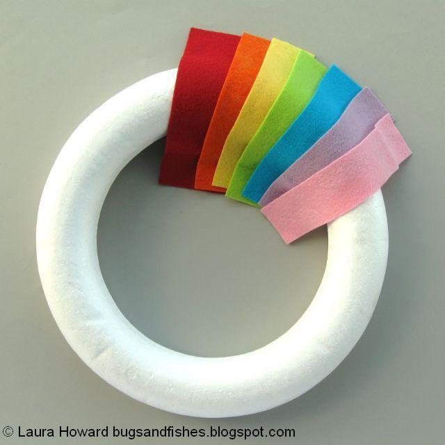 arranging the rainbow felt on the wreath base