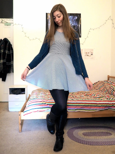 Back to the Start - outfit of blue and white knit dress, blue sparkly cardigan jumper and tall black leather boots