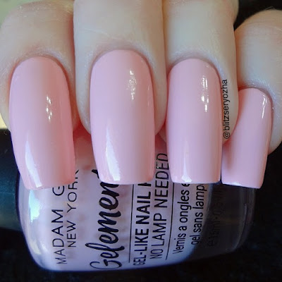 "A swatch photo showing two coats of Madam Glam ""Pop Quiz,"" a light pink creme polish"