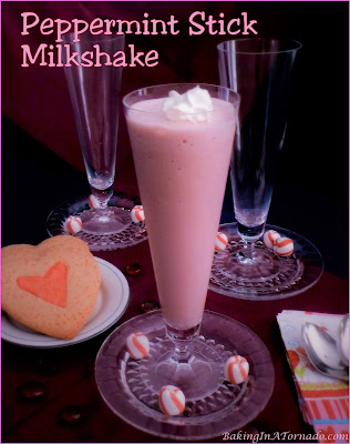 Peppermint Stick Milkshake is for celebrations. Spring, birthday, Valentine's Day, holiday season or any day, this sweet is a treat. | Recipe developed by www.BakingInATornado.com | #recipe #peppermint