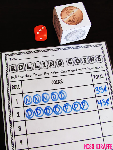 Rolling coins math center to practice making change and counting coins in a fun hands on way and lots of other money games ideas on this site