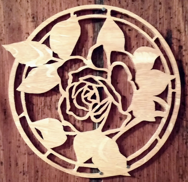 Fretwork Rose I made from oak reclaimed from pallets using my AMT scroll saw