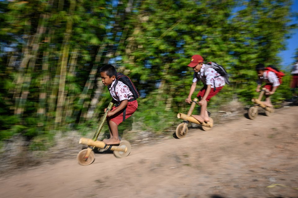 Kids in Indonesia roll with self-made bikes