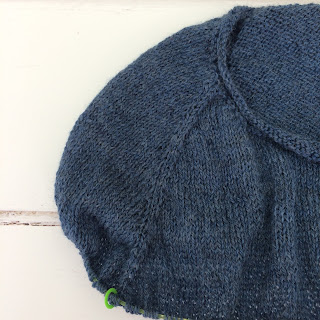 Close up view of raglan increases on knitted sweater