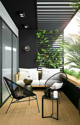 Modern balcony design with black table chairs and white sofa
