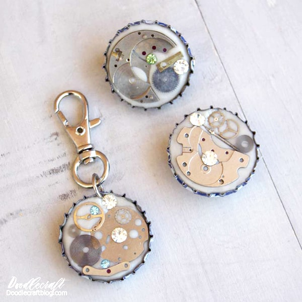 Steampunk keychain, magnet and pin back made with resin clay and watch parts