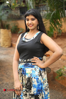 Actress Model Poorni Stills in Floral Long Dress at Silk India Expo Launch  0025.JPG