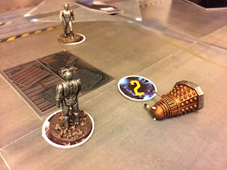 A tense conflict between cybermen and daleks in Doctor Who: Exterminate!