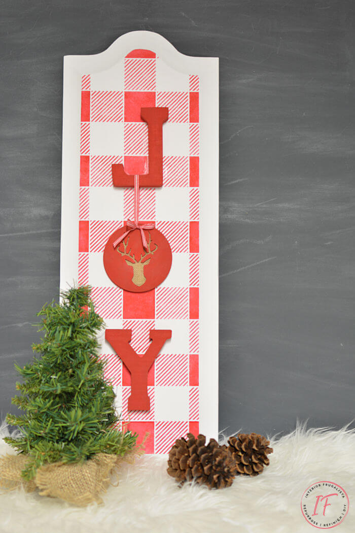 How to repurpose cabinet door panels into festive JOY Christmas Signs with stenciled buffalo check plaid for easy and cheap DIY Christmas decorations.