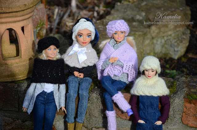 Knitted shawls and caps for Barbie dolls.