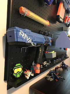 Boy's bedroom, nerf wall, peg board nerf gun