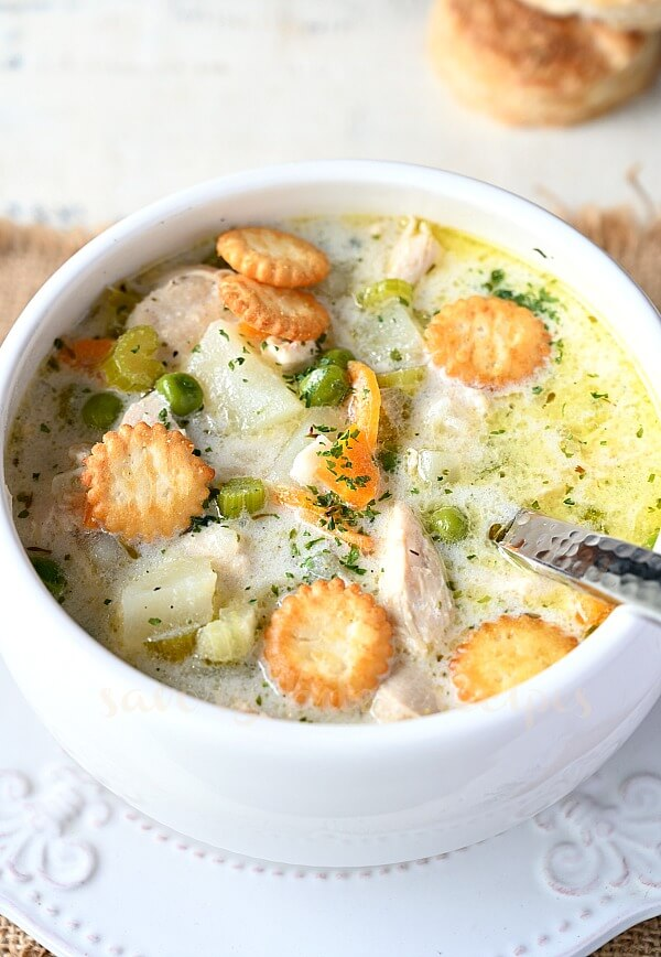 easy chicken pot pie soup in a bowl with oyster crackers