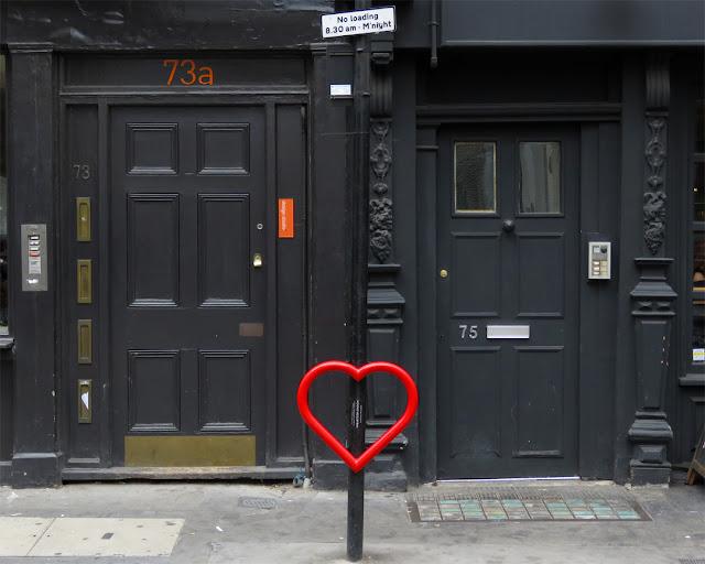 Red heart cycle stand by Graham McLoughlin, Beak Street, Soho, London