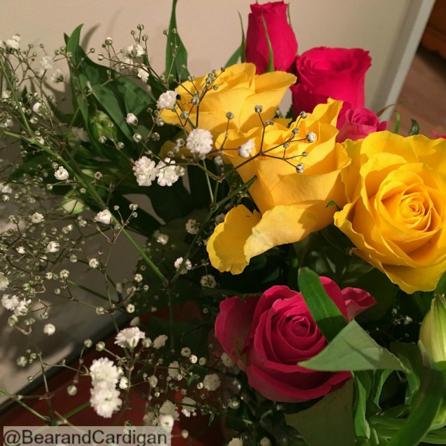 Yellow and red roses with some babies breath.