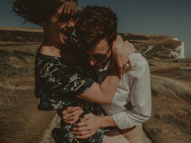 """<img src=""""couple hugging.png"""" alt=""""A man and woman hugging, the right kinda guy."""">"""