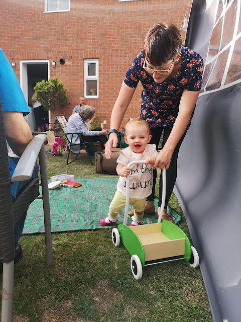 Gift Guide for One Year Old Mum Helping Toddler To Walk  with Ikea Mula Toddle Truck Walker