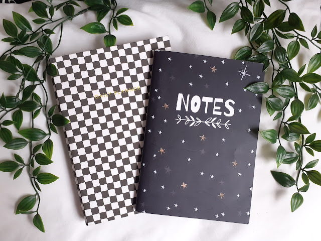two notebooks flatlay with leaves