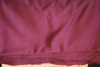 a piece of burgundy ponte