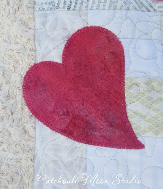 Closeup of whimsical applique heart on table runner