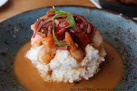 Shrimp n' Grits: Seared Shrimp, Roasted Tomatoes, Virginia Ham, Nora Mill Grits, PBR Chicken Jus at Yardbird Table & Bar