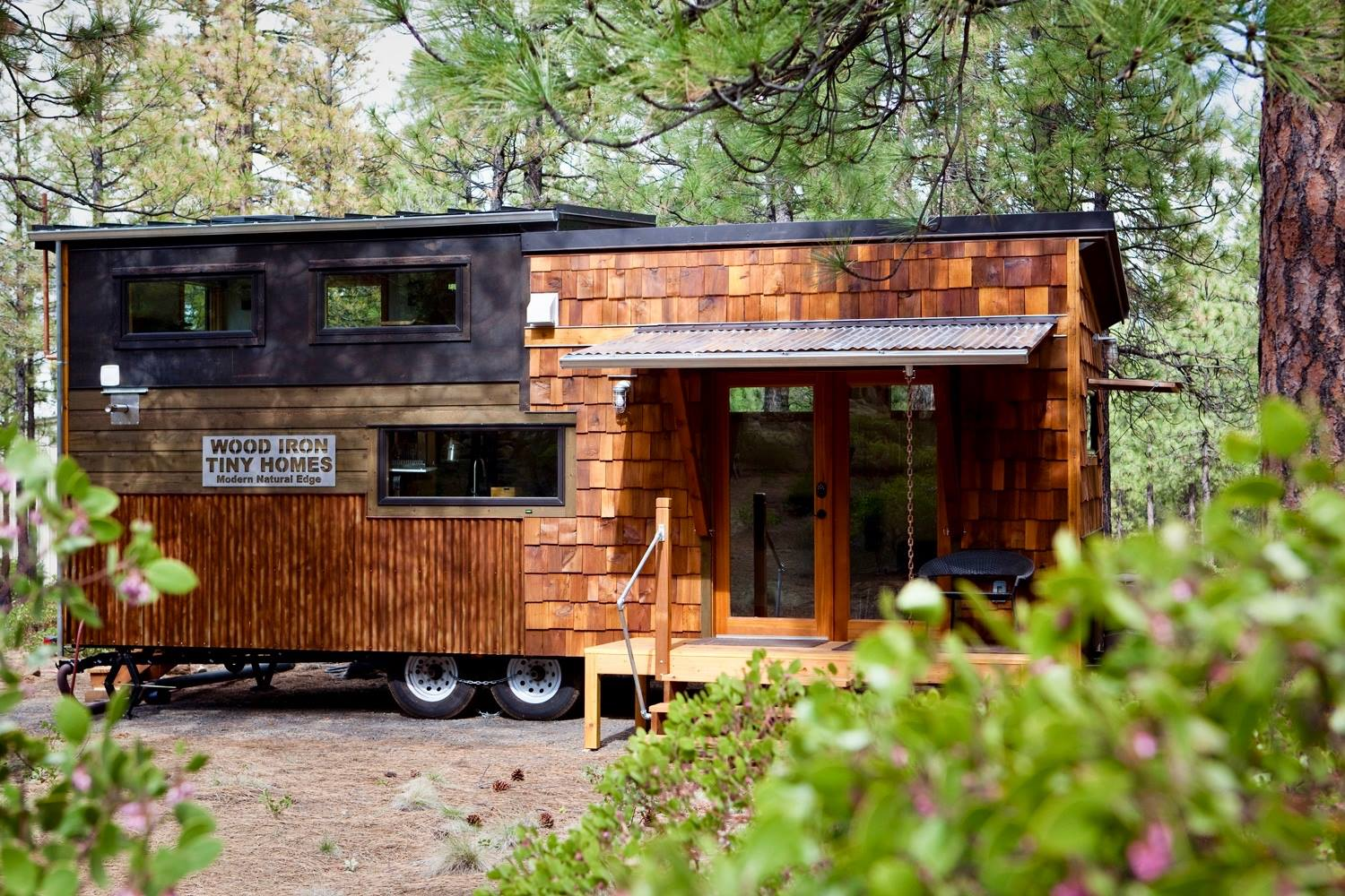 Tiny house town wood iron tiny home for Small livable cabins