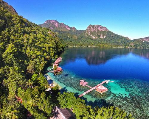 Tinuku.com Travel Ora beach on Seram island quiet haven white sand to snorkel on reefs and beautiful high cliffs