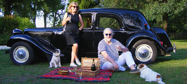 Champagne picnic with a Citroen Traction Avant.  France. Photographed by Susan Walter. Tour the Loire Valley with a classic car and a private guide.