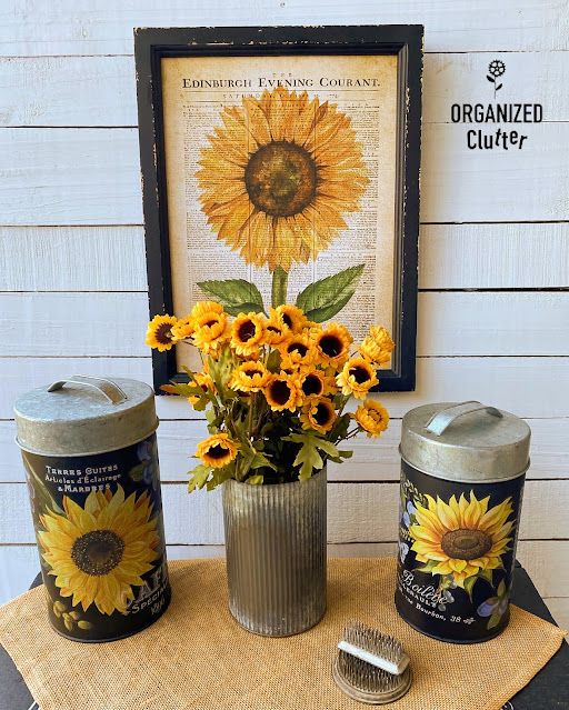 Photo of Goodwill canisters upcycled and staged with fall sunflower motifs.