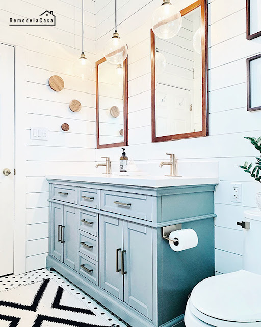 modern vintage bathroom with gray vanity and shiplap wall