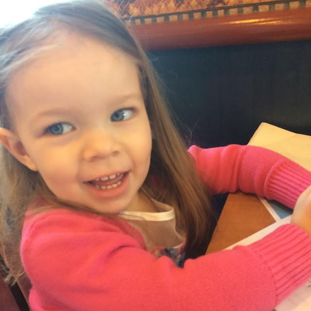 toddler girl in restaurant