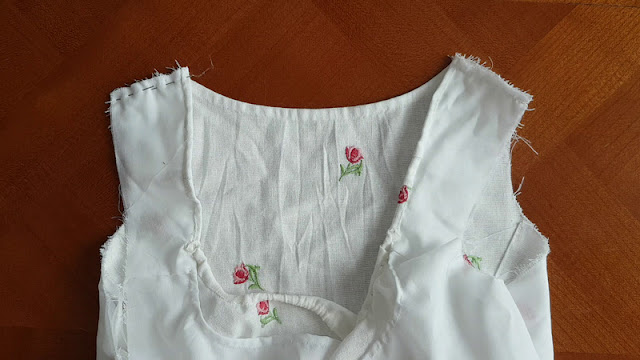 front and back part of the regency bodice are pinned together at the shoulder strap on the left side